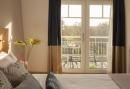 Hotelkamer met balkon en uitzicht